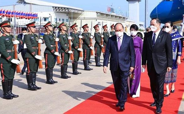 Chủ tịch nước Nguyễn Xuân Phúc bắt đầu thăm chính thức CHDCND Lào - Ảnh 1.