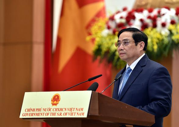 Việt Nam cam kết cùng cộng đồng quốc tế đẩy lùi dịch bệnh, khôi phục phát triển kinh tế - Ảnh 1.