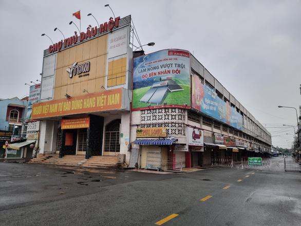 Thủ Dầu Một ngày đầu nới giãn cách: Hàng quán im lìm, chợ vẫn đóng cửa - Ảnh 7.