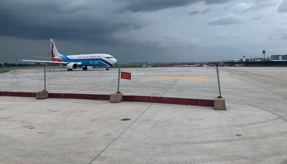 Đưa vào khai thác 2 đường lăn của dự án cải tạo đường băng Tân Sơn Nhất - Ảnh 1.