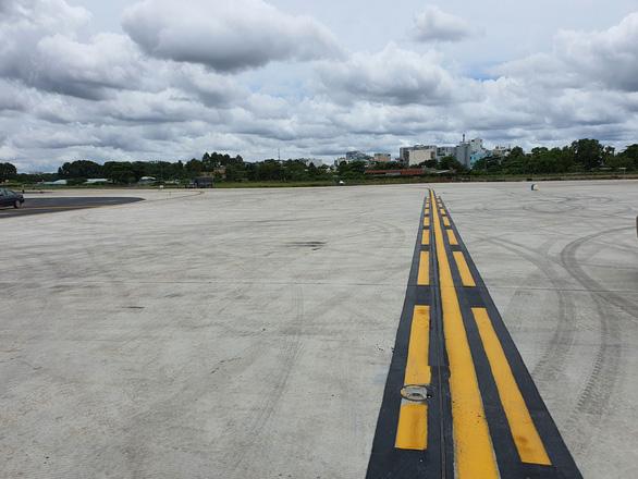 Đưa vào khai thác 2 đường lăn của dự án cải tạo đường băng Tân Sơn Nhất - Ảnh 2.