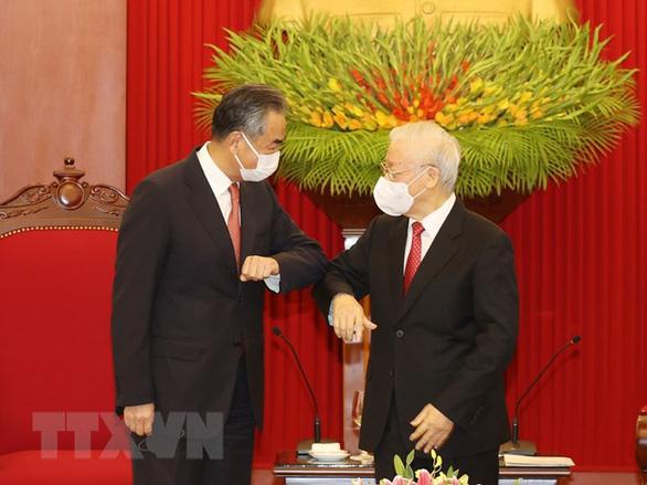 Tổng bí thư Nguyễn Phú Trọng tiếp Ngoại trưởng Trung Quốc Vương Nghị - Ảnh 1.