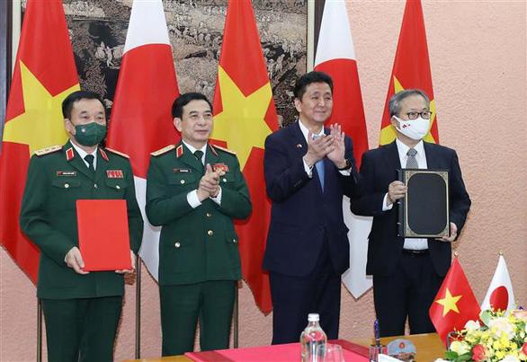 Bộ Quốc phòng hai nước Việt - Nhật ký kết chuyển giao thiết bị, công nghệ quốc phòng - Ảnh 3.