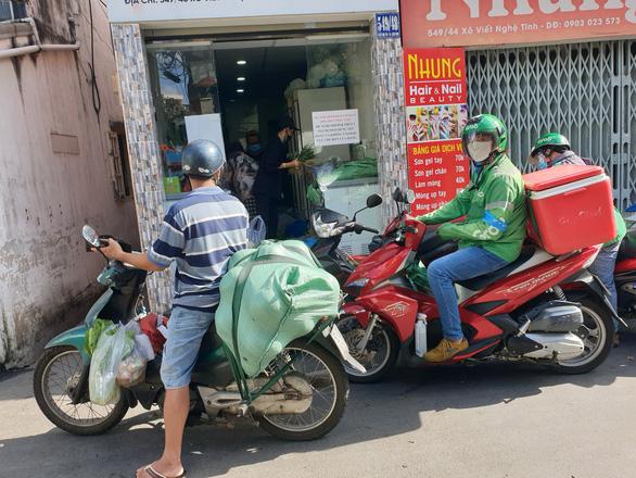 Cước giao hàng nhiều khi cao hơn giá hàng, khách đổ sang mua bán chui - Ảnh 4.