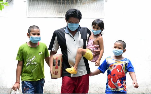 Hơn 1.500 trẻ mồ côi vì dịch COVID-19 ở TP.HCM là vấn đề y tế khẩn cấp - Ảnh 1.