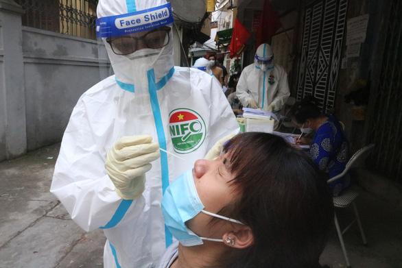 Chính phủ yêu cầu sớm hoàn thiện quy trình thử nghiệm thuốc kháng virus - Ảnh 1.