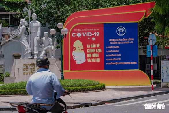 Người phụ nữ bán rau mắc COVID-19, quận Hoàng Mai tìm người đến điểm tiêm và xét nghiệm - Ảnh 1.
