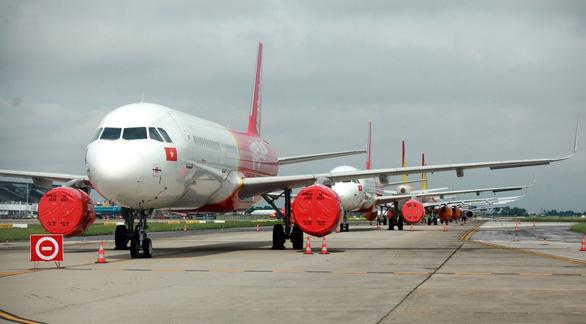 Giới ngân hàng đang tính hỗ trợ các hãng bay tư nhân - Ảnh 1.