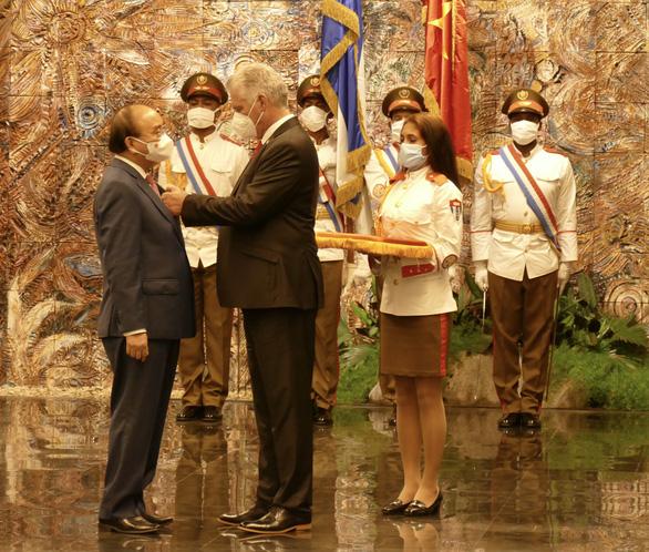Chủ tịch nước Nguyễn Xuân Phúc: Việt Nam - Cuba đoàn kết, nhất định thắng - Ảnh 1.