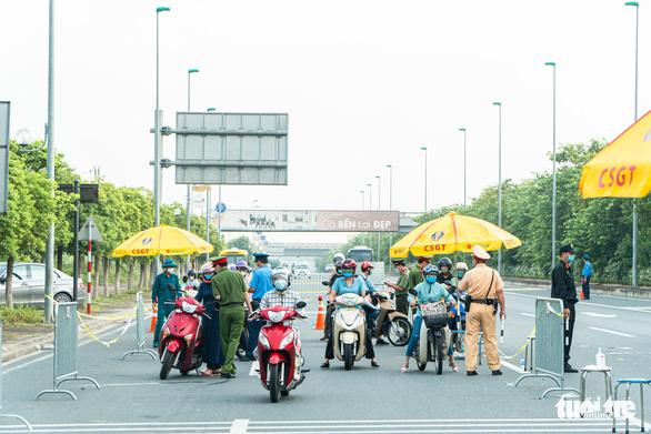 Người dân muốn ra vào Hà Nội từ 21-9 cần giấy tờ, thủ tục gì? - Ảnh 1.