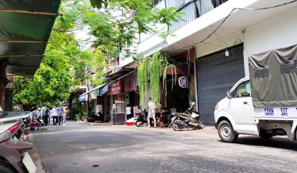 Nổ súng tại phố trung tâm Hải Phòng, một người phát cơm từ thiện bị thương - Ảnh 1.