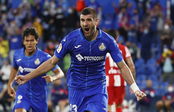 Suarez tỏa sáng, Atletico Madrid thắng ngược Getafe ở phút bù giờ - Ảnh 1.