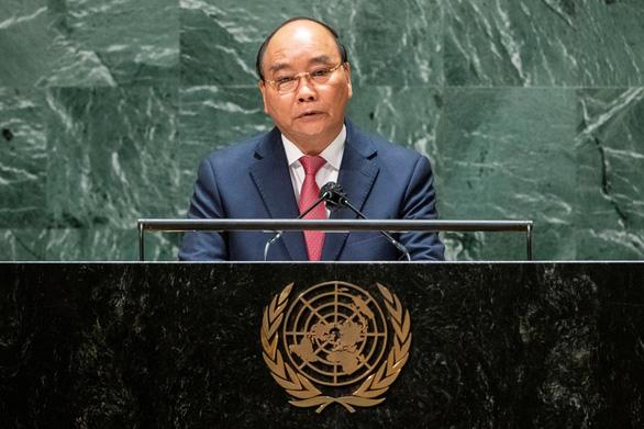 Chủ tịch nước Nguyễn Xuân Phúc thúc giục hợp tác quốc tế về vắc xin ngừa COVID-19 - Ảnh 1.