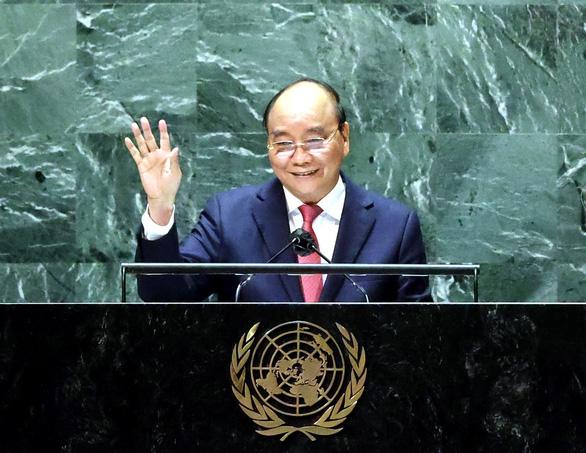 Chủ tịch nước Nguyễn Xuân Phúc thúc giục hợp tác quốc tế về vắc xin ngừa COVID-19 - Ảnh 2.