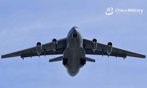 Việt Nam yêu cầu Trung Quốc không tái diễn việc điều máy bay tới Trường Sa - Ảnh 1.