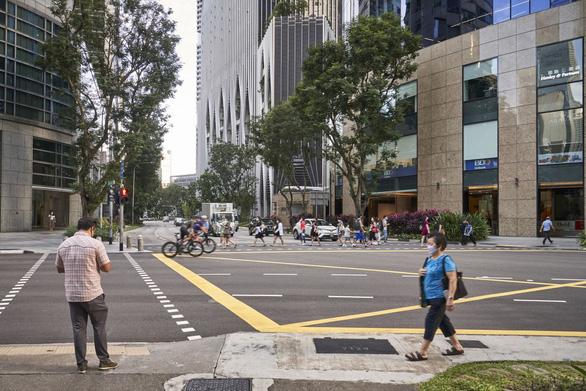Singapore siết phòng dịch trong một tháng vì ca nhiễm tăng - Ảnh 1.