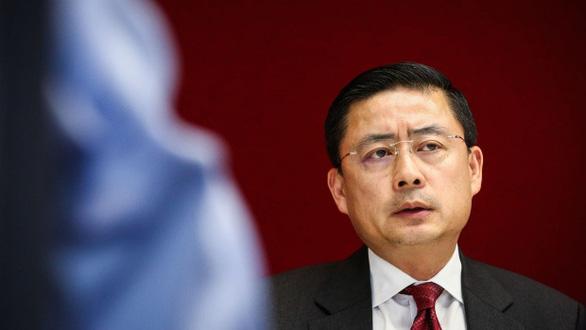 Một trong hai lãnh đạo HNA bị cảnh sát Trung Quốc bắt là công dân Mỹ - Ảnh 1.