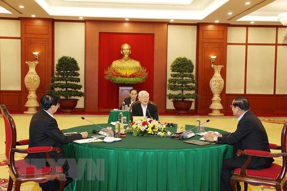 Tổng bí thư Nguyễn Phú Trọng dự cuộc gặp cấp cao Việt Nam - Campuchia - Lào - Ảnh 1.