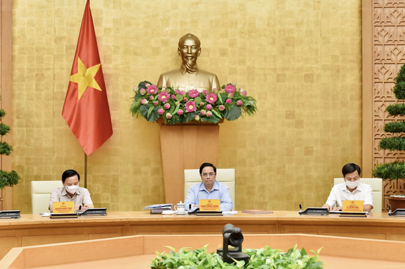 Việt Nam nhập 138 triệu liều vắc xin trong năm nay, sắp có hướng dẫn lộ trình mở cửa trở lại - Ảnh 1.
