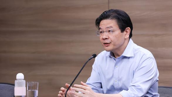 Ca COVID-19 gia tăng, Singapore không loại trừ giãn cách xã hội nghiêm ngặt hơn - Ảnh 1.