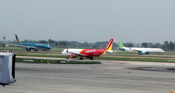Đề xuất áp giá sàn vé máy bay nội địa bằng 20% mức giá tối đa trong 12 tháng - Ảnh 1.