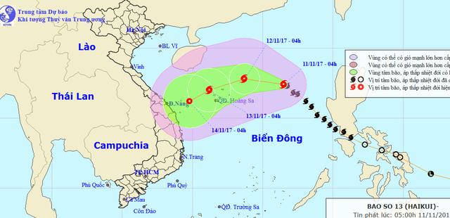 Tâm bão số 13 đang tiến gần quần đảo Hoàng Sa - Ảnh 1.