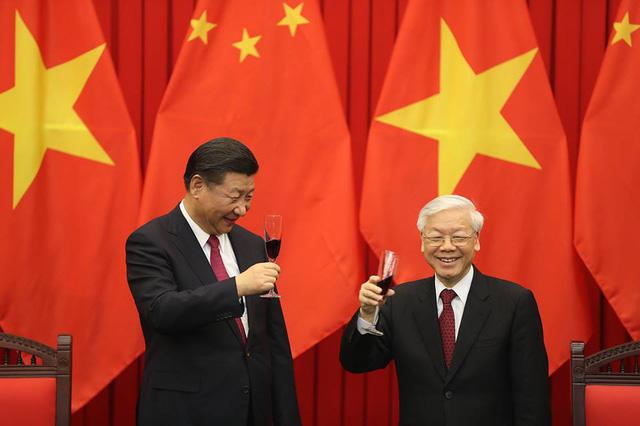 Việt - Trung ký kết 12 văn kiện hợp tác - Ảnh 1.