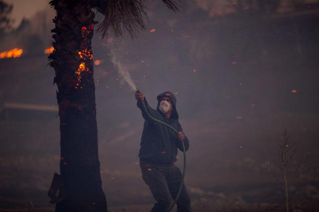 Những hình ảnh kinh hoàng ở biển lửa California - Ảnh 14.