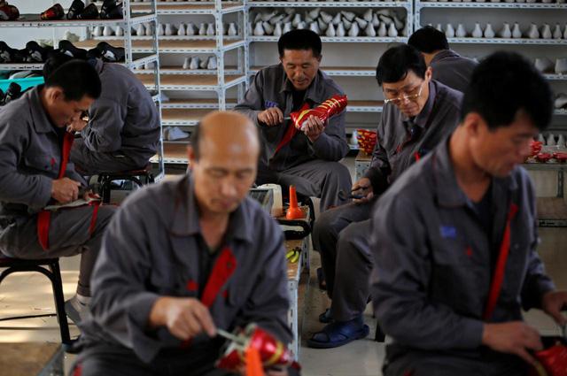 Lao động Triều Tiên tại Trung Quốc rục rịch về nước - Ảnh 1.