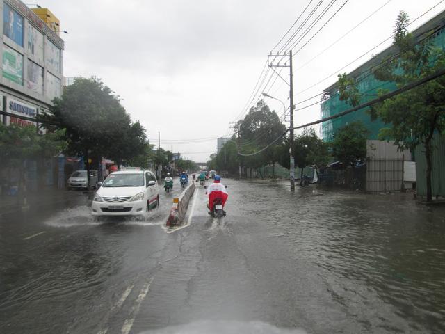 Khởi công dự án chống ngập đường Huỳnh Tấn Phát - Ảnh 1.