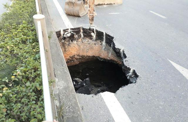 Hố tử thần xuất hiện giữa quốc lộ 18 tại Quảng Ninh - Ảnh 2.
