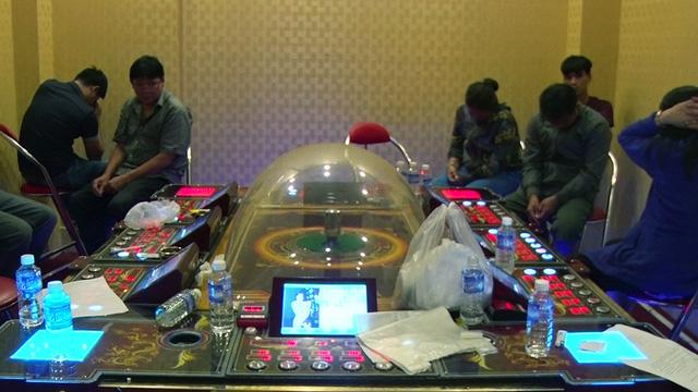 Truy bắt 2 người Trung Quốc liên quan ổ cờ bạc đội lốt game bắn cá - Ảnh 3.