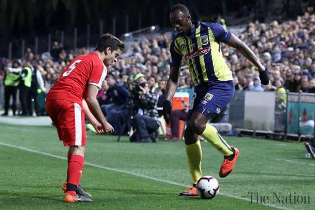 Usain Bolt được mời đến châu Âu đá chuyên nghiệp - Ảnh 1.