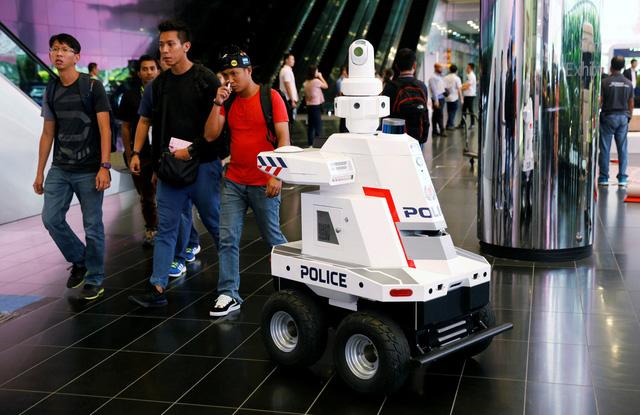 Singapore triển khai robot cảnh sát đi tuần tra  - Ảnh 1.