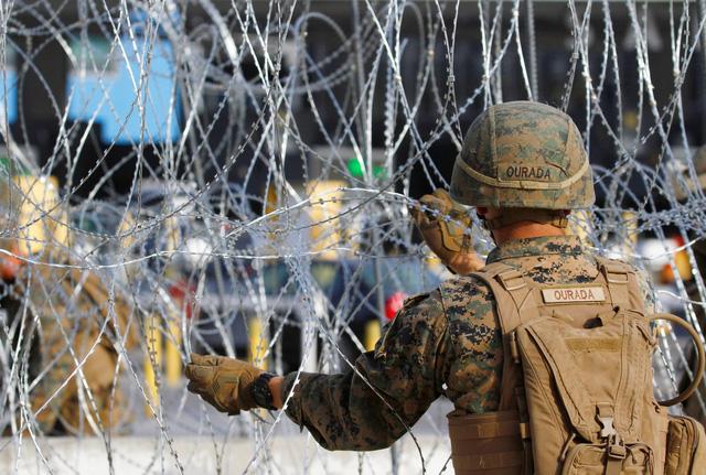 Dòng người di cư bắt đầu xin tị nạn vào Mỹ - Ảnh 2.