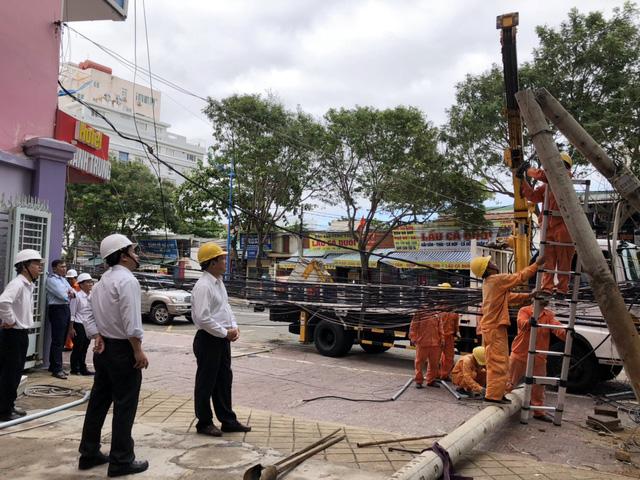 EVN SPC khắc phục thiệt hại sau cơn bão số 9 - Ảnh 1.