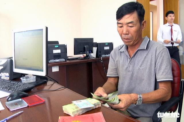 Chi trả tiền hỗ trợ cho người dân nuôi cá lồng bè trên sông La Ngà - Ảnh 2.