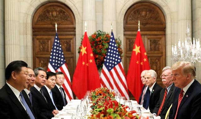 Trung Quốc thông báo Mỹ nhất trí ngừng đánh thuế mới - Ảnh 1.