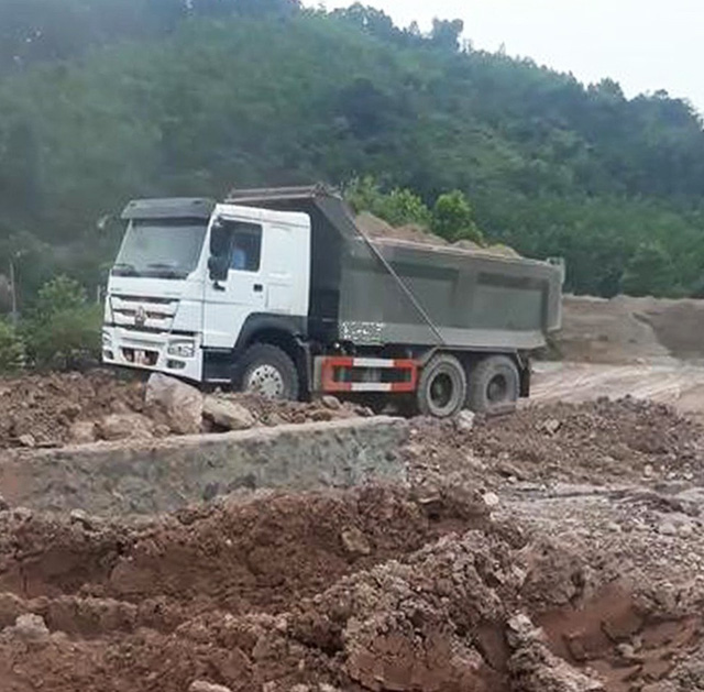 Xử lý nghiêm nhà máy Nhiệt điện Mông Dương 1 để xỉ thải đổ sai quy định - Ảnh 1.