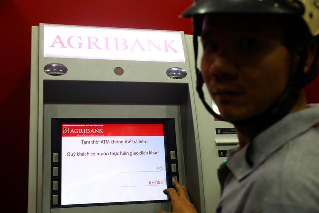 ATM tại TP.HCM kẹt trên diện rộng - Ảnh 3.