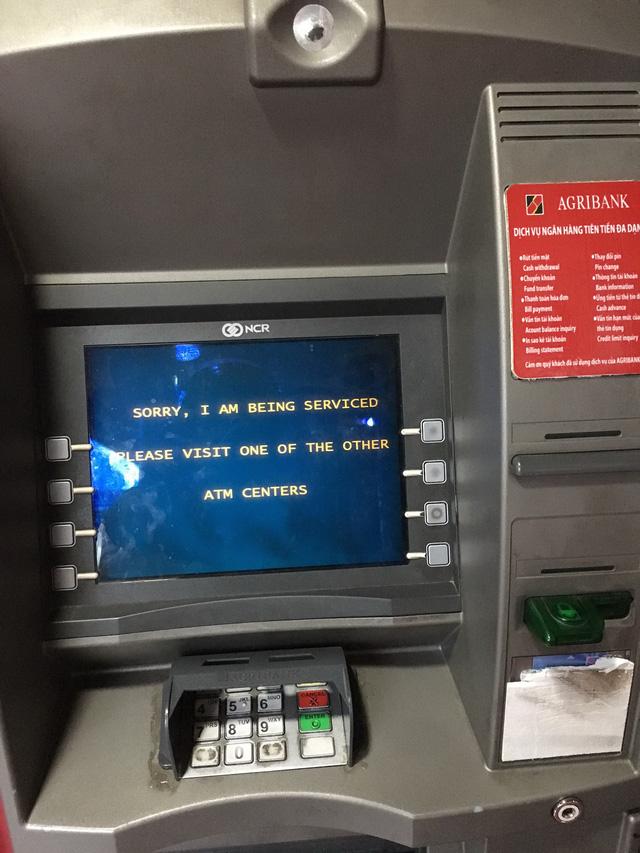 Bở hơi tai rút tiền ATM cận Tết - Ảnh 2.