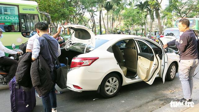 Cần quản lý Uber, Grab như taxi - Ảnh 4.