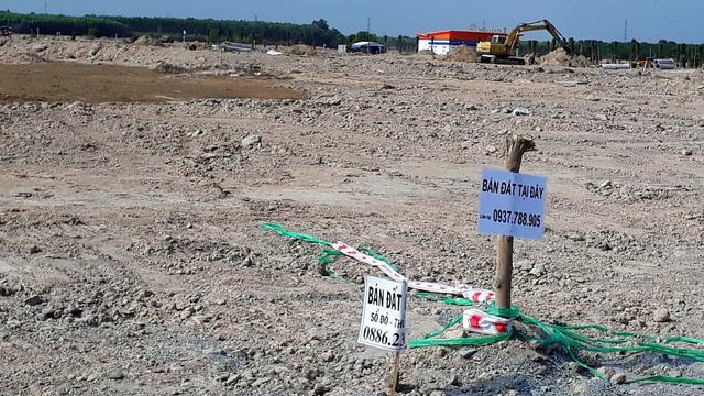 Nhiều doanh nghiệp nhỏ bỏ mặc công ty đi mua đất - Ảnh 1.