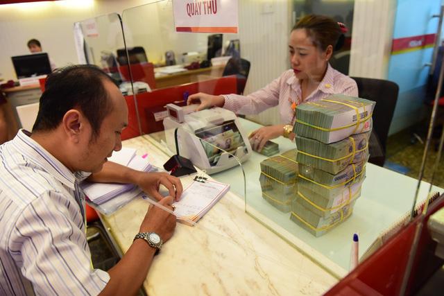 BIDV, VietinBank và nhiều ngân hàng giảm lãi suất huy động - Ảnh 1.