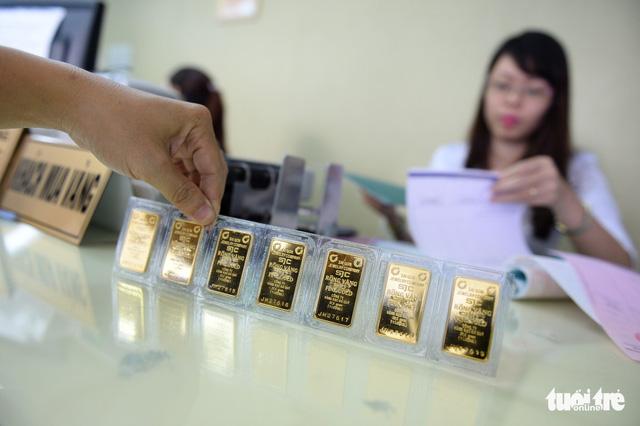 Giá vàng vọt lên hơn 37 triệu đồng do Mỹ - Trung đại chiến? - Ảnh 1.