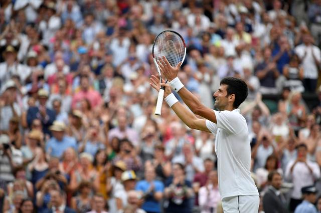 Djokovic đánh bại Nadal bán kết vắt qua hai ngày - Ảnh 1.
