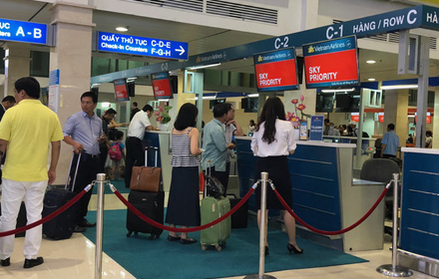 Vietnam Airlines thu phí quản trị hệ thống, bỏ phụ thu xuất vé - Ảnh 1.