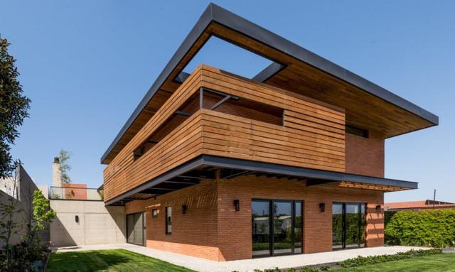 Ngôi nhà bằng vật liệu tái chế vừa đẹp, vừa sang - Ảnh 1.