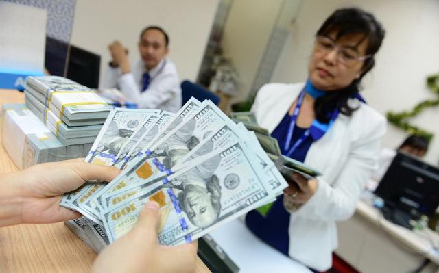 Giá USD tăng, doanh nghiệp lên ruột, Ngân hàng Nhà nước: Không căng - Ảnh 1.