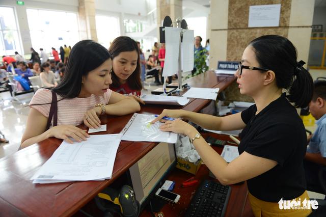 Cục Thuế TP.HCM phát động thi đua mỗi ngày thu 1.000 tỉ - Ảnh 1.